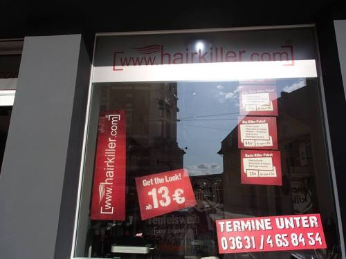 Respectively, the signs in the window are advertising the