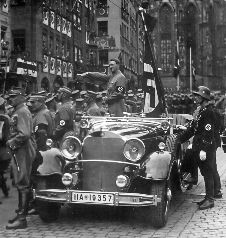 SA troops parade past Hitler at the 1935 Nuremberg Rally